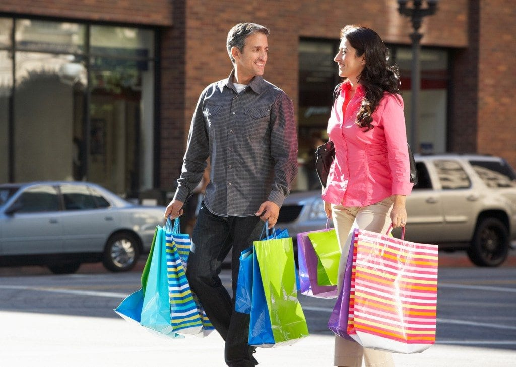 bigstock-Couple-Carrying-Shopping-Bags--44729062