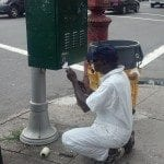 removing-sticker-fro-nyc-dot-traffic-light-box
